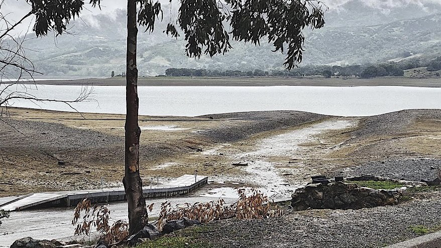 "As of early spring, usually the moment when the Lake is at its highest point, the water is far from its normal shore. The forecast shows low likelihood of any substantial precipitation. (Josh ""Jethro"" Bowers / The Mendocino Voice)"